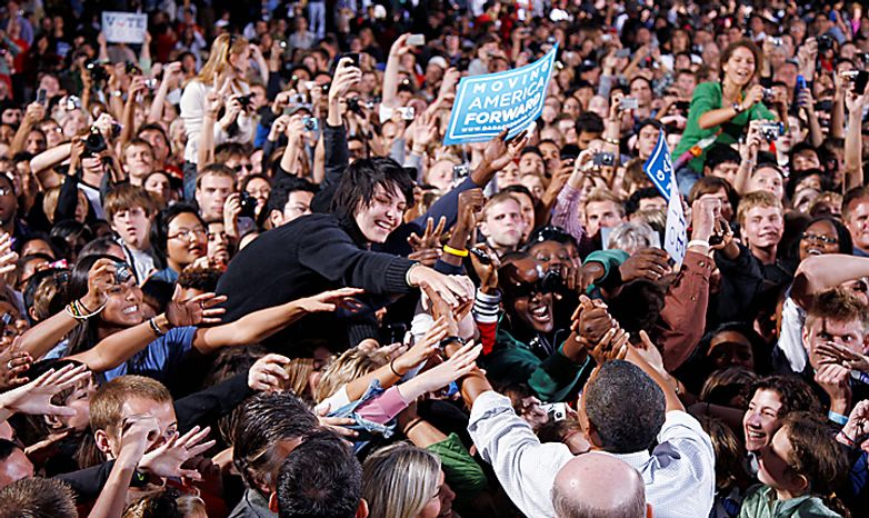 President Barack Obama greets the crowd at a rally at the University of Wisconsin in Madison, Wis., Tuesday, Sept. 28, 2010. (AP Photo/Charles Dharapak)