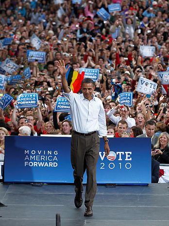 President Barack Obama takes the stage at a rally at the University of Wisconsin in Madison, Wis., Tuesday, Sept. 28, 2010. (AP Photo/Charles Dharapak)