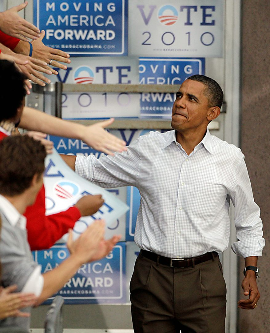 President Barack Obama shakes hands as he arrives at a rally Tuesday, Sept. 28, 2010, on the University of Wisconsin campus in Madison, Wis. (AP Photo/Morry Gash)