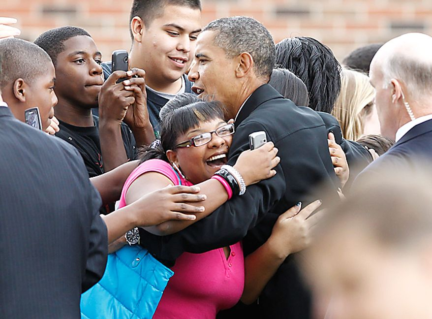 President Barack Obama makes an unscheduled stop and greets students at La Follette High School in Madison, Wis., Tuesday, Sept. 28, 2010. (AP Photo/Charles Dharapak)