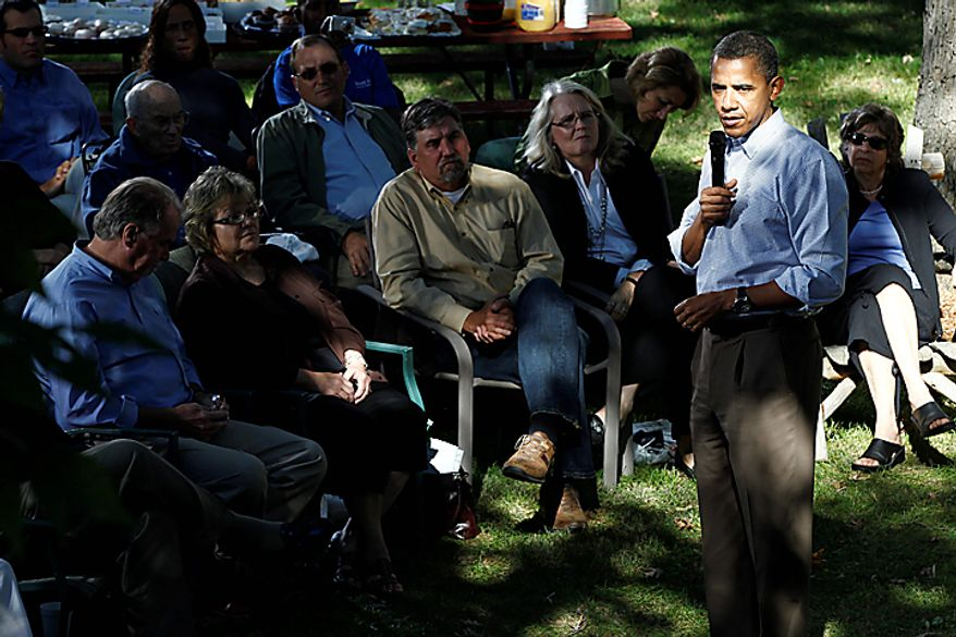 President Barack Obama speaks during a discussion with neighborhood families in the backyard of the Clubb family home in Des Moines, Iowa, Wednesday, Sept. 29, 2010. (AP Photo/Charles Dharapak)