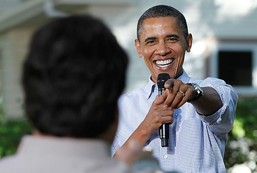 President Barack Obama takes a question during a discussion with neighborhood families in the backyard of the Clubb family home in Des Moines, Iowa, Wednesday, Sept. 29, 2010. (AP Photo/Charles Dharapak)