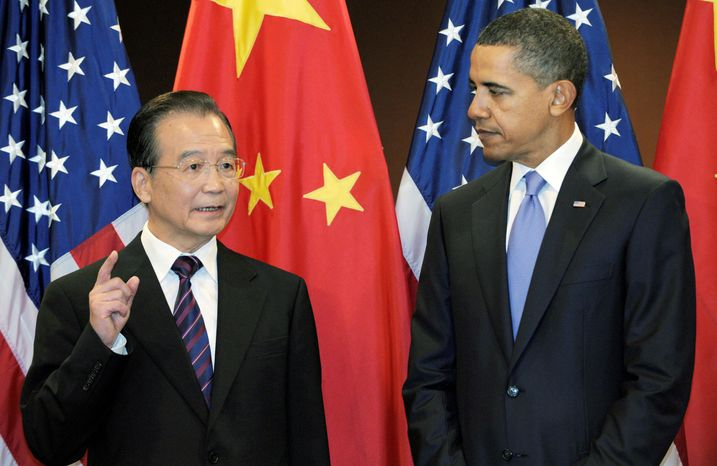 ** FILE ** President Obama and Chinese Premier Wen Jiabao meet at the United Nations on Sept. 23. Mr. Wen promised to allow a stronger yuan but said before the meeting that any rise would not be rapid for fear of causing job losses and business failures. (Associated Press)