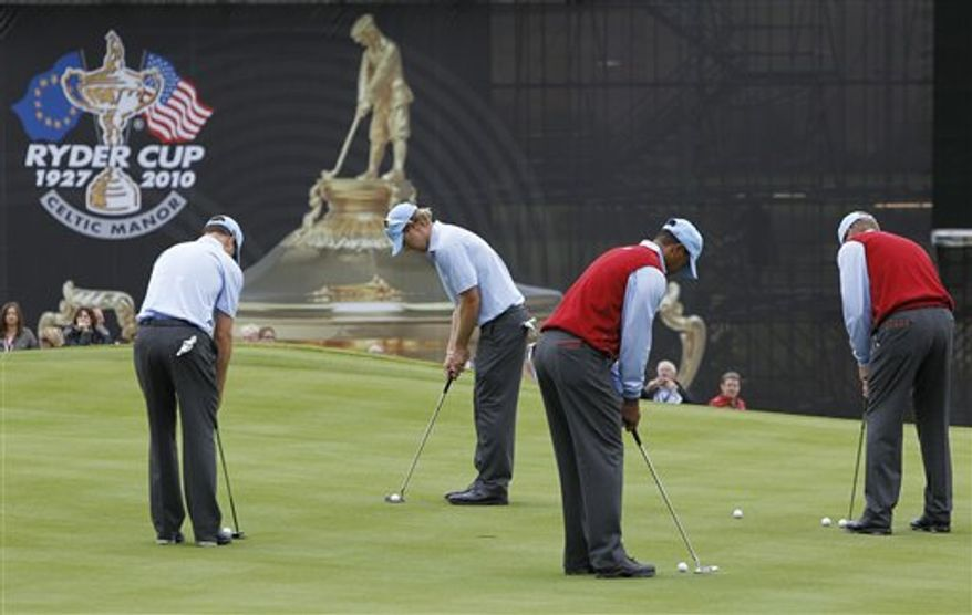 Europe's Rory McIlroy wearing a curly wig hits a tee shot during a practice round at the 2010 Ryder Cup golf tournament at the Celtic Manor golf course in Newport, Wales, Wednesday, Sept. 29, 2010. The tournament starts Friday Oct. 1. (AP Photo/Jon Super)