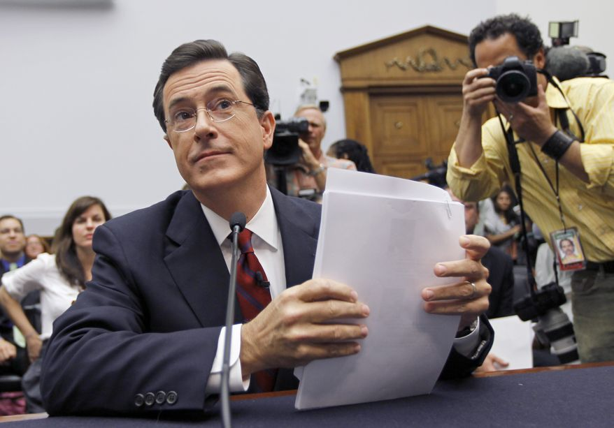 Comedian Stephen Colbert, host of the Colbert Report, prepares to testify on Capitol Hill in Washington, Friday, Sept. 24, 2010, before the House Immigration, Citizenship, Refugees, Border Security and International Law subcommittee hearing on Protecting America's Harvest. (AP Photo/Alex Brandon)