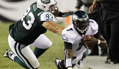 ASSOCIATED PRESS Philadelphia Eagles quarterback Michael Vick, right, is shoved out of bounds by New York Jets defensive lineman Matt Kroul during the first half of an NFL preseason football game, Thursday, Sept. 2, 2010, in Philadelphia.