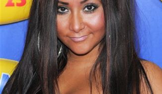 """FILE - In this June 23, 2010 file photo, television personality Nicole """"Snooki"""" Polizzi attends the premiere of """"Grown Ups"""" at the Ziegfeld Theatre in New York. (AP Photo/Evan Agostini, file)"""
