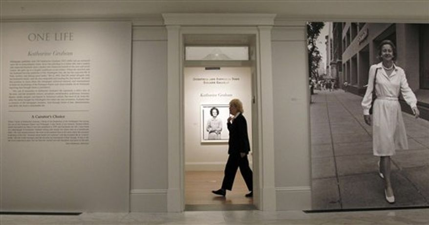 Historian Amy Henderson walks at the Smithsonian National Portrait Gallery's newest exhibit, 'One Life: Katharine Graham', Sept. 29, 2010 in Washington. The exhibit  opens Oct. 1, 2010 and continues through May 30, 2011, is on Graham who was publisher of the Washington Post. (AP Photo/Pablo Martinez Monsivais)