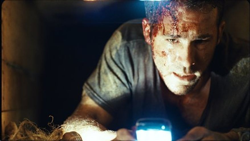 """In this film publicity image released by Lionsgate Entertainment, actor Ryan Reynolds is shown in a scene from """"Buried."""" (AP Photo/Lionsgate Entertainment)"""