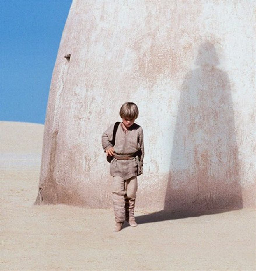 """FILE - In this publicity photo released by Lucasfilm Ltd., actor Jake Lloyd portrays Anakin Skywalker, a young Darth Vader, in """"Star Wars: Episode I, The Phantom Menace.""""  (AP Photo/Lucasfilm Ltd., file)"""