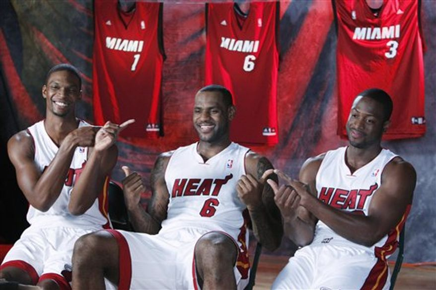 Miami Heat players LeBron James (6)  Dwyane Wade (3) and Chris Bosh (1) arrive for interviews during Media Day, Monday, Sept. 27, 2010 in Coral Gables, Fla. The Heat will begin NBA basketball training camp Tuesday at Hurlburt Field, a U.S. Air Force installation in Florida's Panhandle. (AP Photo/Wilfredo Lee)