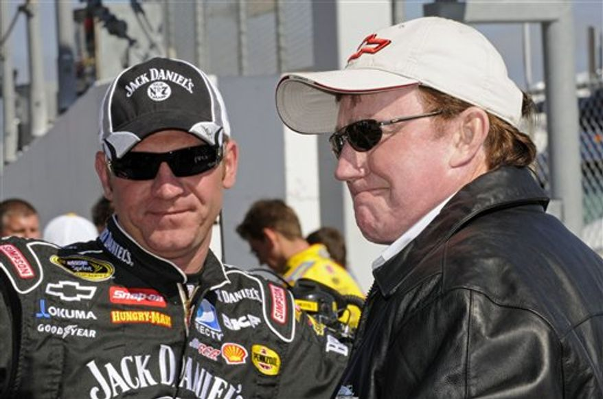 FILE - This Feb. 14, 2008, file photo shows NASCAR team owner Richard Childress, right, talking with driver Clint Bowyer, left, at Daytona International Speedway in Daytona Beach, Fla. Richard Childress Racing is arguing to have Clint Bowyer's 150-point penalty reversed before a NASCAR appeals committee.  Bowyer and his RCR team were penalized last week when the car Bowyer drove to victory at New Hampshire failed inspection.  (AP Photo/Paul Kizzle, File)