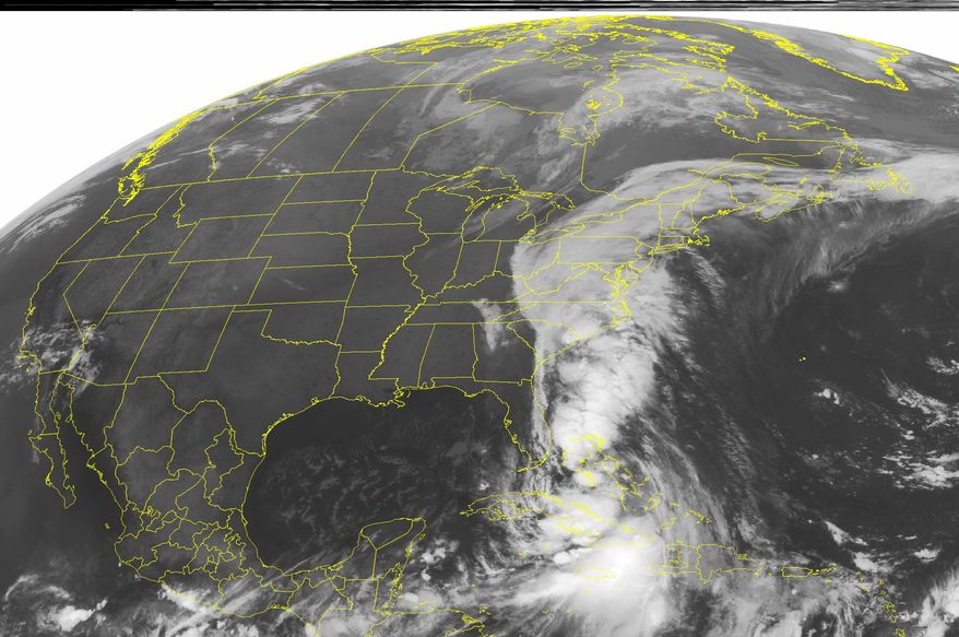 This NOAA satellite image taken Thursday, Sept. 30, 2010, at 1:45 a.m. EDT shows widespread cloud cover over the Eastern Seaboard as an elongated low pressure trough over the East and the remnants of Tropical Storm Nicole usher significant tropical moisture northward, into the region. (AP PHOTO/WEATHER UNDERGROUND)