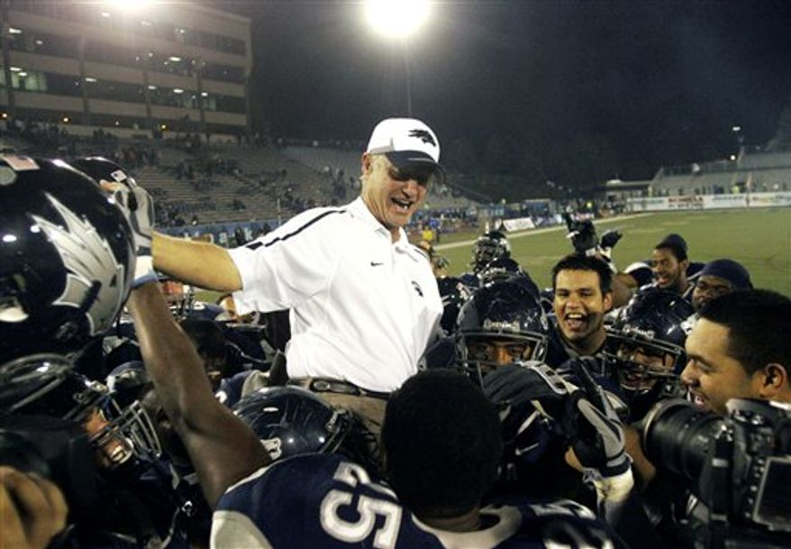 FILE - In this Oct. 9, 2009 file photo, Nevada head coach Chris Ault sits on the shoulders of his players after the NCAA college football game in celebration of his 200th win at Mackay Stadium in Reno, Nev. Ault, who was Nevada's quarterback from 1965-67 and is the winningest coach in school history with a record of 210-96-1 in his 26th season. Nevada (4-0) heads to UNLV (1-3) ranked in the Top 25 for the first time since 1948 after back-to-back wins against Cal and BYU.  (AP Photo/Brad Horn, File)