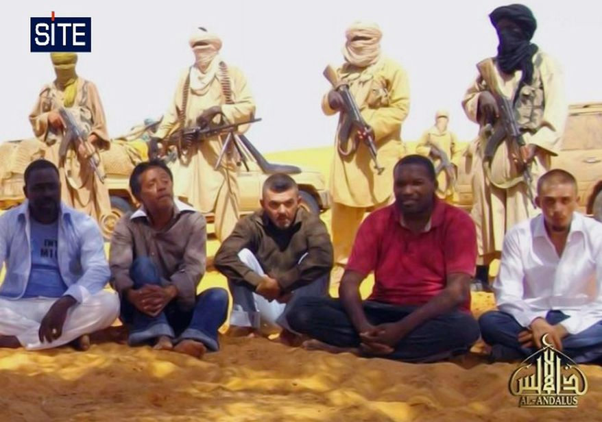 This image taken from video and provided by U.S.-based SITE Intelligence Group Thursday Sept. 30, 2010 shows the first images of a group of foreign hostages working for a French energy company who were seized in Niger two weeks ago by an al Qaeda offshoot, according to the group that monitors terrorism. The hostages were grabbed in the middle of the night on Sept. 16 from their guarded villas in the uranium mining town of Arlit in Niger where they worked for French nuclear giant Areva. Five are French citizens, the other two are from Togo and Madagascar. (AP Photo/SITE)