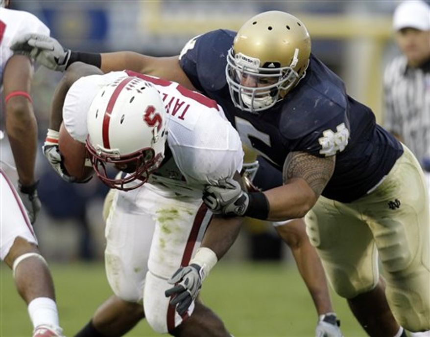 In this photo taken, Saturday, Sept. 25, 2010, Notre Dame linebacker Manti Te'o, right, tackles Stanford running back Stepfan Taylor during second half of an NCAA college football game in South Bend, Ind.  Te'o's 21 tackles in the game were the most by a Notre Dame player in four years (AP Photo/Michael Conroy)
