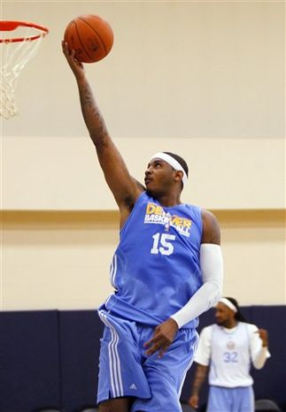 Denver Nuggets forward Carmelo Anthony lays the ball into the basket on the first day of basketball practice this season for the NBA team, at the Pepsi Center in Denver on Tuesday, Sept. 28, 2010. (AP Photo/Ed Andrieski)