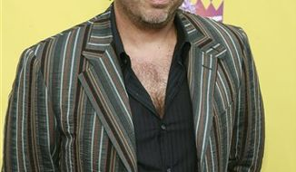"""FILE - In this July 22, 2007 file photo, Greg Giraldo arrives at the """"Comedy Central Roast of Flavor Flav"""" in Burbank, Calif.  Giraldo,44, a stand-up comedian who specialized in rants and insult-filled roasts, died on Wednesday, Sept. 29, 2010 at the Robert Wood Johnson Hospital in New Brunswick, N.J., after being hospitalized days earlier. (AP Photo/Matt Sayles, file)"""