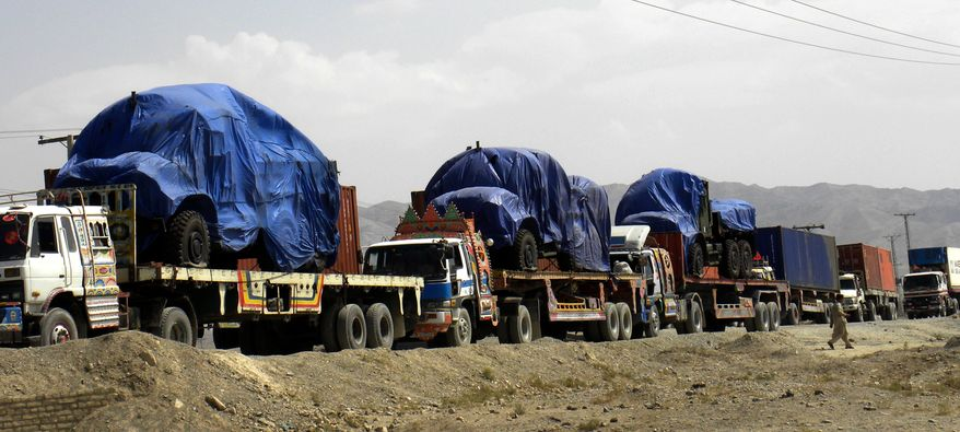 Afghanistan-bound NATO trucks carrying supplies for NATO forces make their way through the Pakistani border town of Chaman on Thursday, Sept. 30, 2010. Pakistan blocked a vital supply route for U.S. and NATO troops in Afghanistan on Thursday in apparent retaliation for a purported cross-border helicopter strike by the coalition that killed three Pakistani frontier troops. (AP Photo/Shah Khalid)