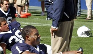 FILE - In this Sept. 25, 2010, file photo Penn State coach Joe Paterno visits with quarterback Rob Bolden (1) before an NCAA college football game against Temple at Beaver Stadium in State College, Pa. (AP Photo/Gene J. Puskar, File)