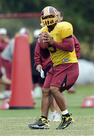 Washington Redskins quarterback Donovan McNabb (5) looks to hand the ball off to running back Clinton Portis, left, during practice at the NFL football team's facility, Wednesday, Sept. 29, 2010, at Redskins Park in Ashburn, Va. (AP Photo/Nick Wass)