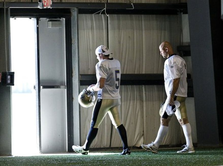 New Orleans Saints place kicker Garrett Hartley (5) and newly-signed veteran kicker John Carney (3) walk to the practice field during the start of workouts at  their NFL football training facility in Metairie, La., Wednesday, Sept. 29, 2010. (AP Photo/Gerald Herbert)