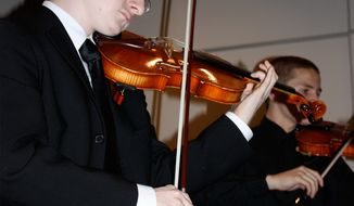 Tyler Clementi plays with the Ridgewood High School Orchestra at a benefit dinner in 2009. (AP Photo/The Record of Bergen County, Ryan Pifher)