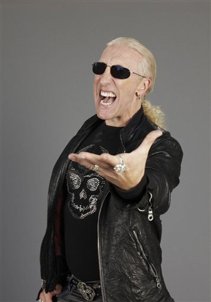 FILE - In this Jan. 24, 1986 file photo, Dee Snider of Twisted Sister performs at Radio City Music Hall in New York. (AP Photo/Corey Struller, file)