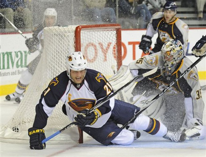 Nashville Predators left wing Sergei Kostitsyn (74), of Belarus, celebrates after scoring a goal against the Atlanta Thrashers during the first period of a pre-season NHL hockey game in Nashville, Tenn., Monday, Sept. 27, 2010. (AP Photo/Frederick Breedon)