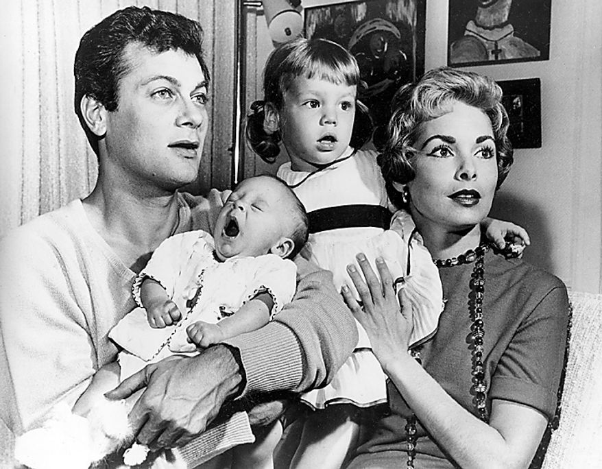 Tony Curtis and Janet Leigh are shown with their daughters Kelly, 2 1/2, and newborn Jamie Lee in Hollywood, Ca., in this Jan. 16, 1959 file photo. Curtis died Wednesday Sept. 29, 2010 at his Las Vegas area home of a cardiac arrest at 85 according to the Clark County, Nev. coroner. (AP Photo, File)