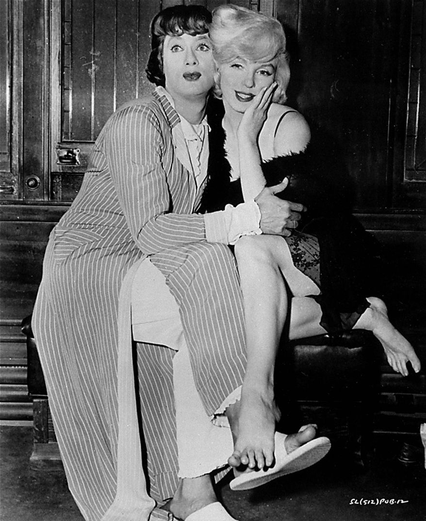Tony Curtis and Marilyn Monroe in the hilarious milestone comedy,  Some Like It Hot,  produced, directed and co-scripted by Billy Wilder, United Artists, in this 1959 file photo. Curtis has died at 85 according to the Clark County, Nev. coroner. (AP Photo, File)