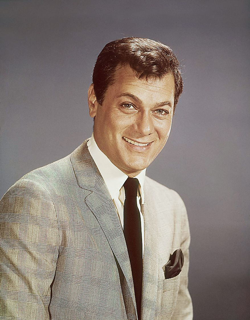 Actor Tony Curtis is shown in this 1965 file photo. Curtis, whose real name was Bernard Schwartz, was perhaps most known for his comedic turn in Billy Wilder's 'Some Like It Hot' with co-stars Marilyn Monroe and Jack Lemmon has died at 85 according to the Clark County, Nev. coroner. (AP Photo, File)