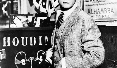 "Actor Tony Curtis portrays magician Harry Houdini in the 1953 Hollywood movie ""Houdini."" Curtis has died at 85 according to the Clark County, Nev. coroner.  (AP Photo, File)"