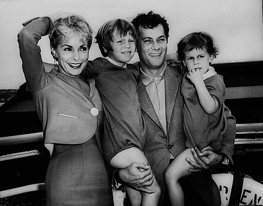 """Tony Curtis and Janet Leigh pose with their children, Kelly 5, and Jamie, 2 1/2  in this Sept. 19,1961 file photo prior to their departure on the SS Argentina for the Argentine where Curtis was to do location filming for the movie """"Taras Bulba."""" Curtis died Wednesday Sept. 29, 2010 at his Las Vegas area home of a cardiac arrest at 85 according to the Clark County, Nev. coroner. (AP Photo/HO - File)"""