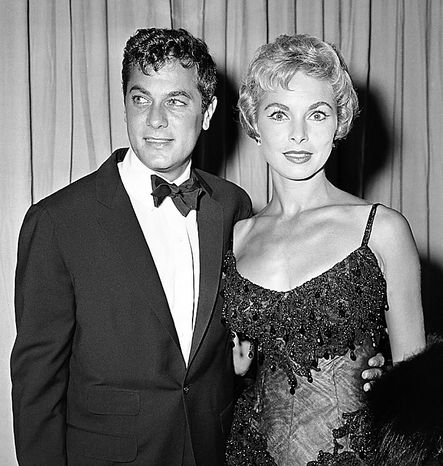 Actor Tony Curtis and his wife Janet Leigh are shown at Academy Awards, in this April 6, 1959 file photo taken in Hollywood. Curtis died Wednesday Sept. 29, 2010 at his Las Vegas area home of a cardiac arrest at 85 according to the Clark County, Nev. coroner. (AP Photo, File)