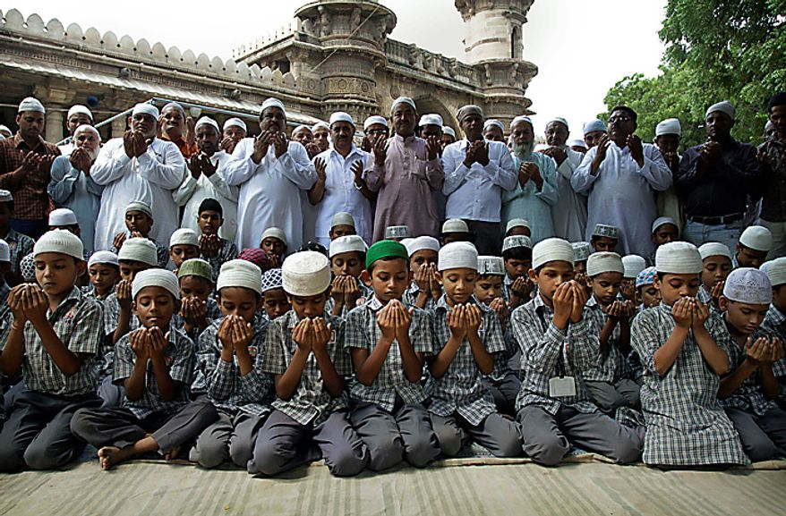 Muslims prays for peace and communal harmony before the Ayodhya verdict, at a mosque in Ahmadabad, India, Thursday,Sept. 30, 2010. An Indian court ruled Thursday that a disputed holy site that has sparked bloody communal riots across the country in the past should be divided between the Hindu and Muslim communities.However, the court gave the Hindu community control over the section where the now demolished Babri Mosque stood and where a small makeshift tent-shrine to the Hindu god Rama rests. While both Muslim and Hindu lawyers vowed to appeal to the Supreme Court, the compromise ruling seemed unlikely to set off a new round of violence, as the government had feared. (AP Photo/Ajit Solanki)