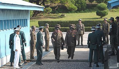 North Korean head of delegate Col. Ri Sun Gyun, center, crosses the border line with other delegates for a military meeting at the south side of the truce village of Panmunjom in the demilitarized zone (DMZ) that separates the two Koreas since the Korean War, north of Seoul, South Korea, Thursday, Sept. 30, 2010. (AP Photo/ Shin So-young, Korea Pool)