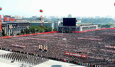 In this Thursday, Sept. 30, 2010 photo released by Korean Central News Agency via Korea News Service in Tokyo, North Koreans gather in Kim Il Sung Square during a ceremony hosted by the Pyongyang city to celebrate the re-election of their leader Kim Jong Il to the ruling party's top position, general secretary of the Workers' Party of Korea, in Pyongyang, North Korea. (AP Photo/Korean Central News Agency via Korea News Service)
