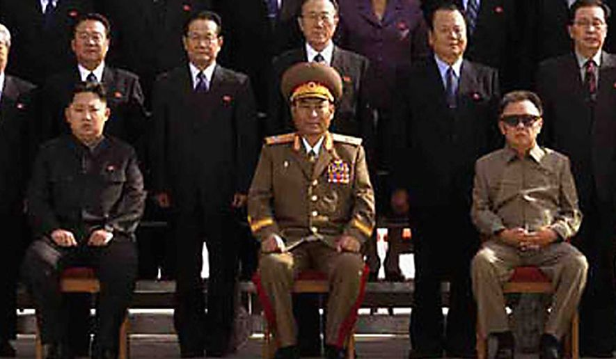 In this undated photo released on Thursday, Sept. 30, 2010, by Korean Central News Agency via Korea News Service, North Korean Leader Kim Jong Il, right, poses for a group photo with newly elected members of the central leadership body of the Workers Party of Korea  (WPK) and the participants in the WPK Conference in front of the Kumsusan Memorial Palace, in Pyongyang, North Korea. A north Korean newspaper which used the photo Thursday identified Kim Jong Un, the third son of  Kim Jong Il, as being in the photo, believed to be at left. At center is Vice Marshal Ri Yong Ho.  (AP Photo/Korean Central News Agency via Korea News Service)