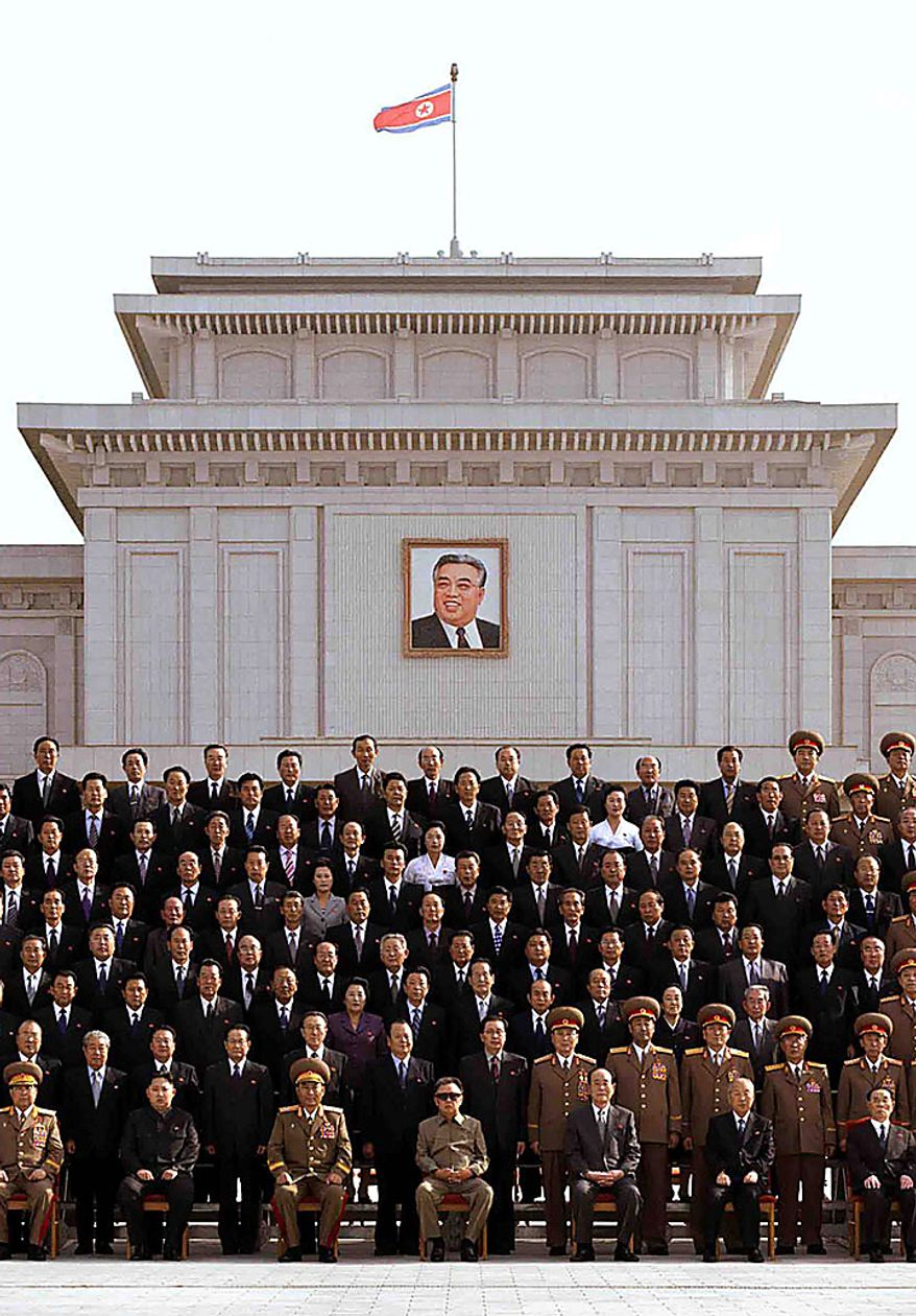 In this undated photo released on Thursday, Sept. 30, 2010 by Korean Central News Agency via Korea News Service, North Korean leader Kim Jong Il, center in front, poses with senior Workers' Party officials in Pyongyang, North Korea. (AP Photo/Korean Central News Agency via Korea News Service)