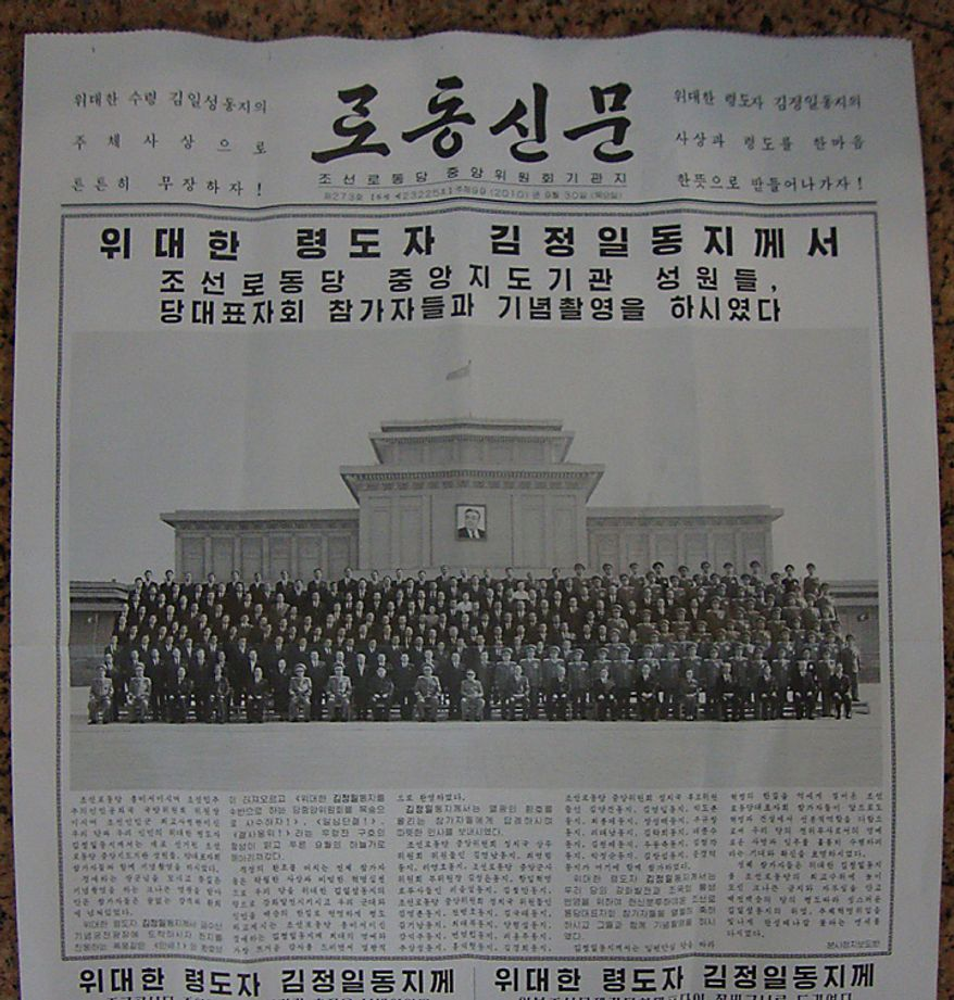 The front page of North Korea's Rodong Sinmun newspaper of Thursday, Sept. 30, 2010 shows a group photo of senior North Korean officials, including Kim Jong Un, believed to be the third son of Kim Jong Il. The newspaper identified Kim Jong Un as being in the photo, in the front row, eighth from left. Kim Jong Il is at tenth left in the front row. (AP Photo)