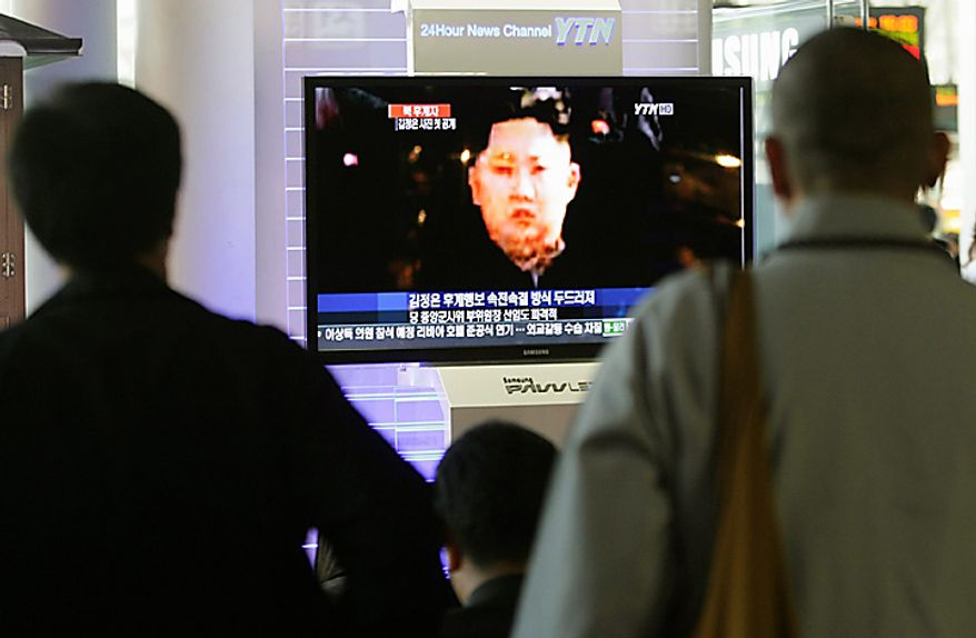 South Koreans watch a TV news program showing a picture of a man believed to be Kim Jong Un, the third son of North Korean Leader Kim Jong Il, at the Seoul Railway Station in Seoul, South Korea, Thursday, Sept. 30, 2010.(AP Photo/Ahn Young-joon)