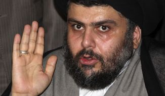 In this Monday, July 19, 2010, file photo, Muqtada al-Sadr, one of Iraq's most powerful Shi'ite political clerics, speaks to reporters in Damascus, Syria. Aides to Mr. al-Sadr say his powerful political bloc has agreed to support Iraqi Prime Minister Nouri al-Maliki's bid to stay in power and end a nearly seven-month political impasse. (AP Photo/Bassem Tellawi, File)