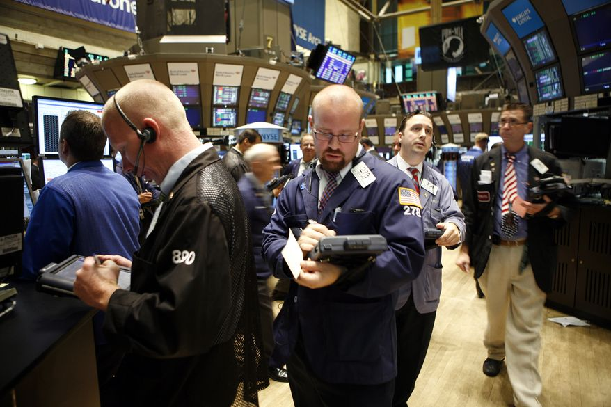 Traders and specialists work the trading floor of the New York Stock Exchange after the start of trading, Wednesday, Sept. 1, 2010, in New York. (AP Photo/David Karp)