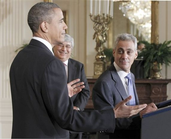 President Barack Obama and his new interim White House Chief of Staff Pete Rouse, center, look on as outgoing Chief of Staff Rahm Emanuel, right, speaks in the East Room of the White House in Washington, Friday, Oct. 1, 2010. (AP Photo/Pablo Martinez Monsivais)