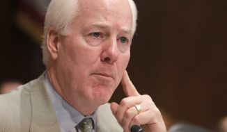 ** FILE ** In this April 16, 2010, file photo, Sen. John Cornyn, Texas Republican, is seen on Capitol Hill in Washington. (AP Photo/Charles Dharapak, File)