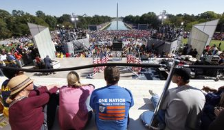 "Activists gather at the Lincoln Memorial to participate in the ""One Nation Working Together"" rally to promote job creation, diversity and tolerance on Saturday, Oct. 2, 2010, in Washington. (AP Photo/J. Scott Applewhite)"