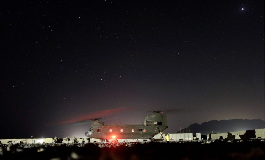A U.S. Army helicopter prepares to leave a forward operating base in Afghanistan. Republican lawmakers say there are not enough troops to man a counter-rocket, -artillery and -mortar battery used effectively by soldiers in Iraq to intercept enemy rounds headed for forward operating bases. (Associated Press)