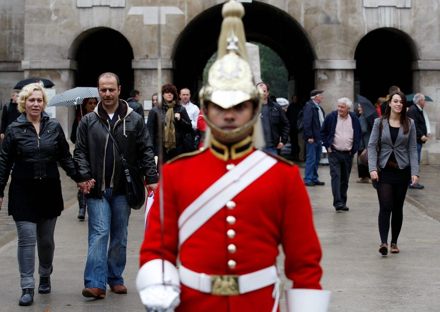 Tourists visit the Horse Guards Parade in London on Sunday. The U.S. government has warned citizens to be vigilant while traveling in Europe because of the threat of al Qaeda commando-style attacks. But the alert is not as strong as a warning, a State Department spokesman said. (Associated Press)