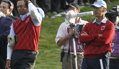 ASSOCIATED PRESS U.S. team captain Corey Pavin, right, and player Tiger Woods  watch the play on the third day of the 2010 Ryder Cup golf tournament at the Celtic Manor Resort in Newport, Wales, Sunday, Oct. 3, 2010.